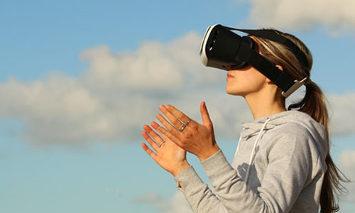 A woman wearing virtual reality goggles